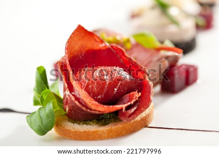 Jamon Canapes with Pesto Sauce - stock photo