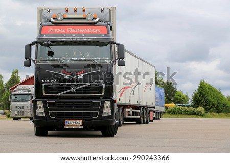 JAMSA, FINLAND - JUNE 18, 2015: Volvo FH16 semi truck leaves a truck stop. Volvo Trucks certify all engines for the diesel HVO. - stock photo
