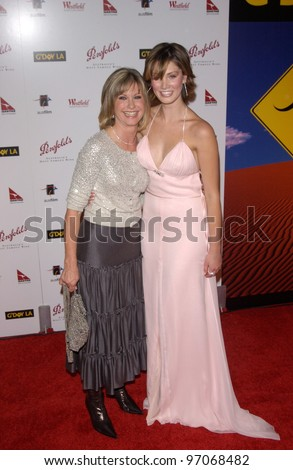 Jan 15, 2005; Los Angeles, CA:  OLIVIA NEWTON JOHN (left) & DELTA GOODREM at the G'Day LA Penfolds Gala honoring Australian talent.