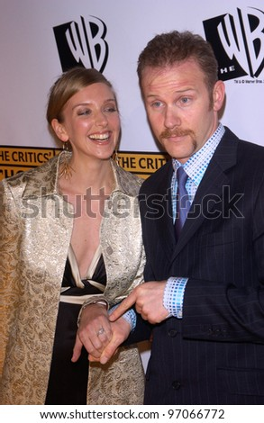 Jan 10, 2005; Los Angeles, CA:  Supersize Me documentary filmmaker MORGAN SPURLOCK & fiance at the 10th Annual Critcs' Choice Awards at the Wiltern Theatre, Los Angeles. - stock photo