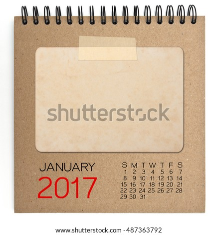 January 2017 calendar on brown notebook with old blank photo
