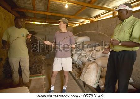 JANUARY 2005 - Humane society Chief Executive Officer, Wayne Pacelle, reviewing animal snares at David Sheldrick Wildlife Trust in Tsavo national Park, Kenya - stock photo