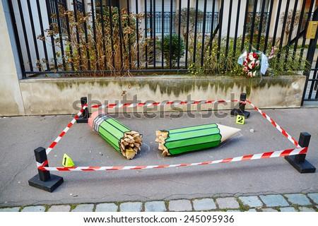 "JANUARY 18, 2015 - PARIS: Broken pencil at the 10 Rue Nicolas-Appert, symbol of the massacre at the French magazine ""Charlie Hebdo"" - stock photo"