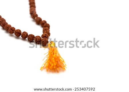 Japa mala. Prayer beads made from the seeds of the rudraksha tree. Isolated on white background.