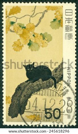 JAPAN - CIRCA 1978: A post stamp printed in Japan and shows Bonsai tree and black cat, circa 1978 - stock photo