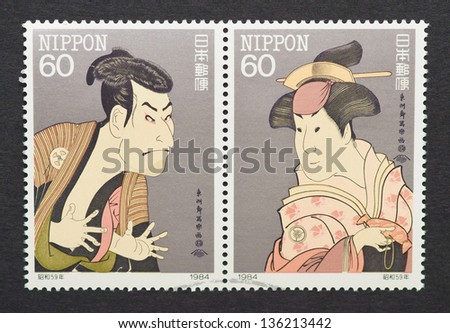 JAPAN - CIRCA 1984: a postage stamp printed in Japan showing an image of a man and a woman wearing traditional dresses, circa 1984.