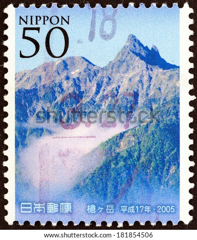 """JAPAN - CIRCA 2005: A stamp printed in Japan from the """"Mountains and Flowers - The 100th Anniversary of the Japanese Alpine Club """" issue shows Hodakadake, circa 2005.  - stock photo"""