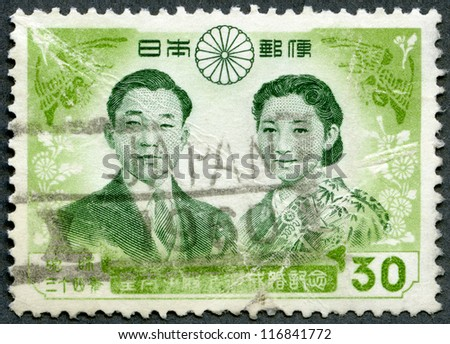 JAPAN - CIRCA 1959: A stamp printed in Japan shows Prince Akihito and Princess Michiko, circa 1959 - stock photo