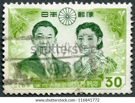 JAPAN - CIRCA 1959: A stamp printed in Japan shows Prince Akihito and Princess Michiko, circa 1959 - stock photo