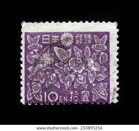 JAPAN - CIRCA 1947: A stamp printed in Japan shows two birds on the background of floral pattern, circa 1947