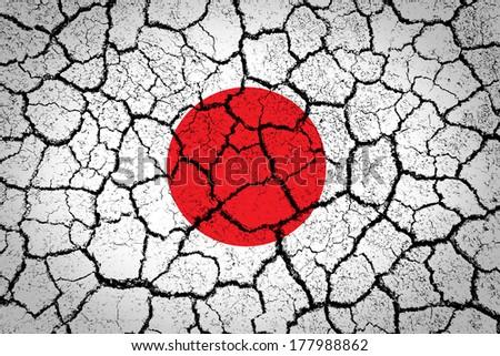 Japan flag painted on cracked ground - stock photo