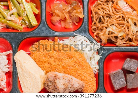 Japan Food set of meat fritter and other in a box. Japan food (Bento). - stock photo