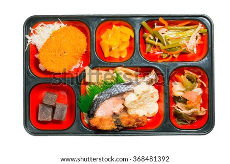 Japan Food set of salmon grilled and other in a box isolated on white / Japan food (Bento). - stock photo
