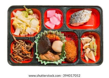 Japan Food set of steamed Chicken and other in a box isolated on white / Japan food (Bento).  Object with clipping path - stock photo