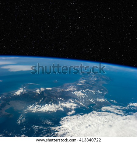 Japan from space with stars above. Elements of this image furnished by NASA.  - stock photo