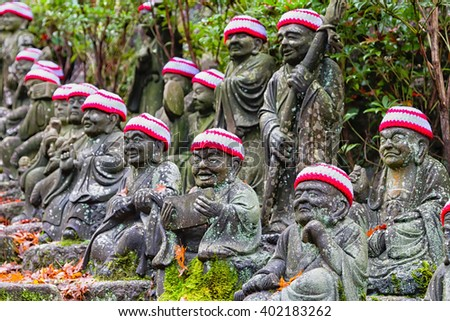 Japan - Ksitigarbha statues in Daishouin Buddhist temple on the island Miyajima in Hatsukaichi (Hiroshima prefecture, region Chugoku). - stock photo