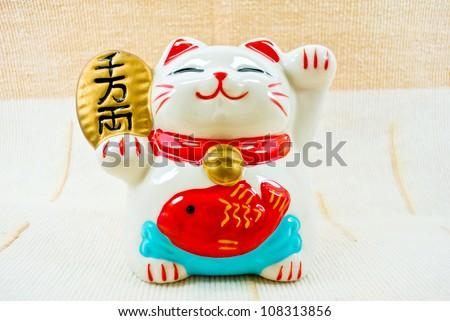 Japan lucky cat - stock photo