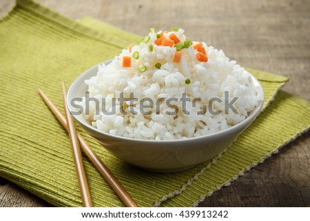 Japan rice with chopsticks on a fabric mat - stock photo