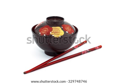 Japanese bowl and chopsticks isolated on white background  - stock photo