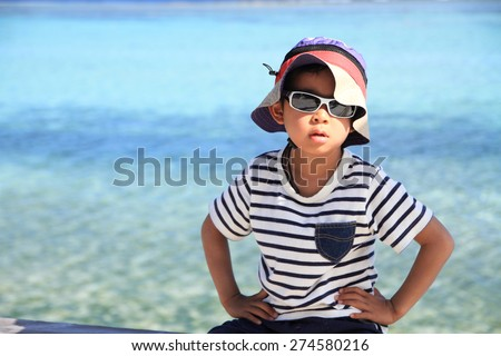 Japanese boy and blue ocean (5 years old) - stock photo
