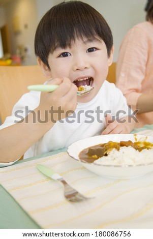 Japanese boy eating curry rice
