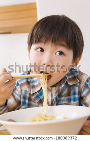 Japanese boy eating ramen