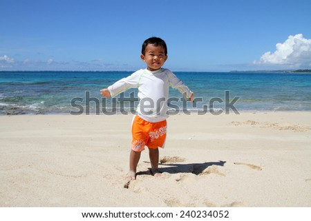 Japanese boy on the beach (2 years old) - stock photo