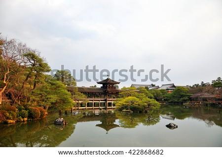 Japanese bridge in the garden of Heian Jingu (Heian shrine), Kyoto, Japan. Bridge of peace - stock photo