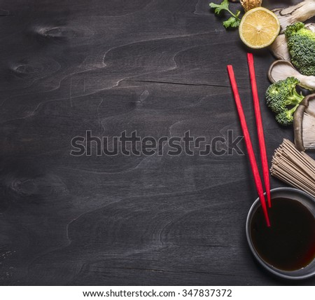 Japanese buckwheat noodles with oyster mushrooms, red chopsticks cilantro on wooden rustic background top view close up border, place for text  - stock photo