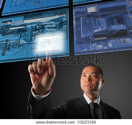 japanese  businessman select project on virtual floating screen - stock photo