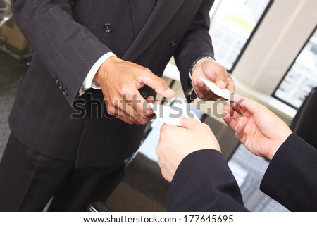 Japanese businessman exchange business cards stock photo royalty japanese businessman to exchange business cards reheart Gallery