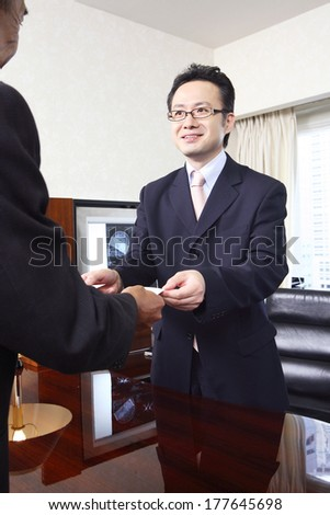 Japanese businessman exchange business cards stock photo 177645698 japanese businessman to exchange business cards reheart Gallery