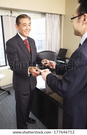 Japanese businessman exchange business cards stock photo 100 legal japanese businessman to exchange business cards reheart Gallery