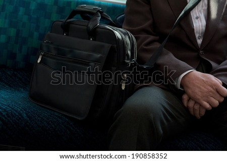Japanese Businessmen sitting on seat in train  - stock photo