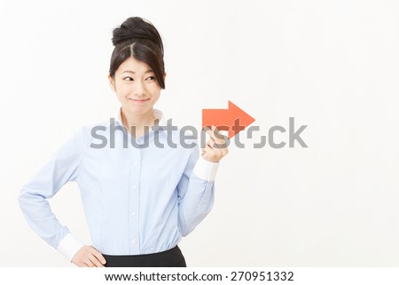 Japanese businesswoman pointing side - stock photo