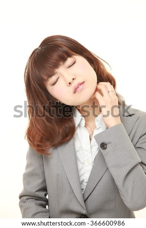 Japanese businesswoman scratching her neck - stock photo