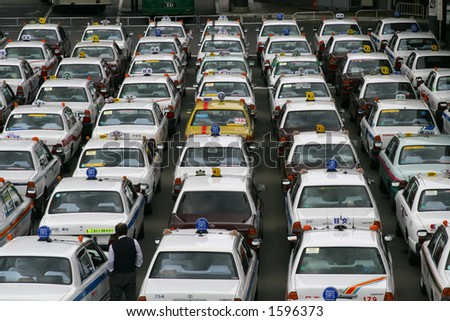 Japanese Cabs Lined Up at Sendai Station - Yellow Cab Contrasting - 1 - stock photo
