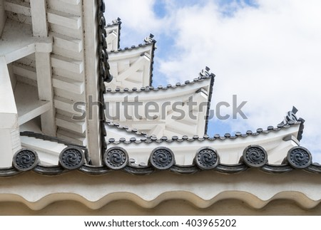 Japanese Castle Roof Layers Blue sky - stock photo