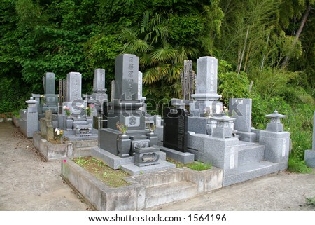 Japanese cemetery with several graves
