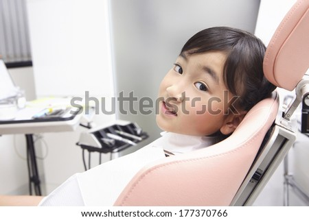 Japanese child undergoing dental treatment