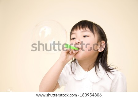 Japanese Children making soap bubbles