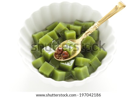 Japanese confectionery, green tea gelatin jelly with Mitsumame bean - stock photo