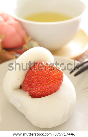 Japanese confectionery, strawberry rice cake with green tea - stock photo