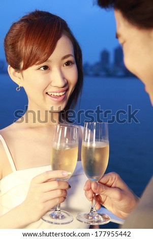 Japanese Couple to toast with champagne