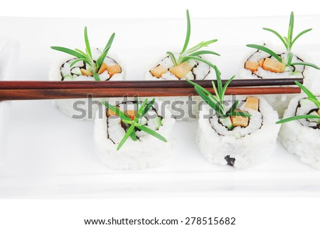 Japanese Cuisine - California Sushi Roll with Avocado, Cream Cheese and Raw Salmon inside. With wasabi and ginger. isolated over white background - stock photo