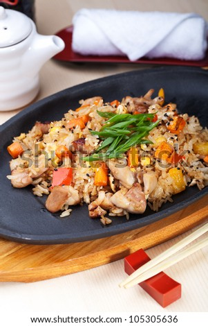 Japanese Cuisine - Fried Rice with Vegetables and Chicken Breast. - stock photo