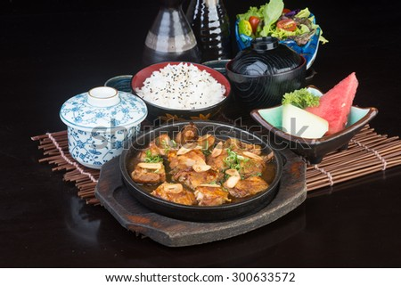 japanese cuisine. hot plate chicken on background - stock photo