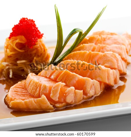 Japanese Cuisine - Salmon Fillet with Noodles and Sauce - stock photo