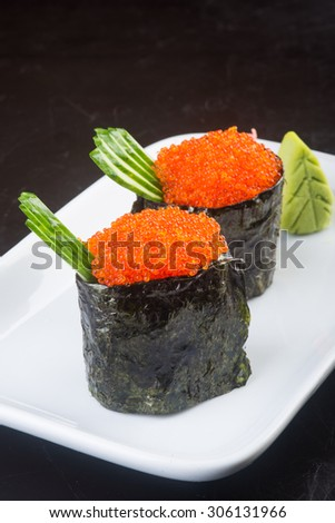 japanese cuisine. salmon roe on the background.