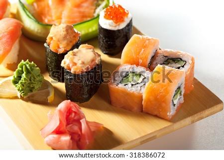 Japanese Cuisine - Salmon Sushi Set. Nigiri and Sashimi with Gunkan Maki Sushi with Red Roe - stock photo